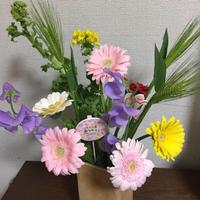 解体工事と花束