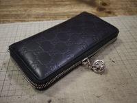 グッチの財布のファスナーが閉めても閉まらなくなって
